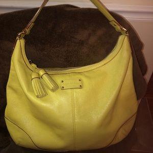 large yellow Kate Spade hobo handbag